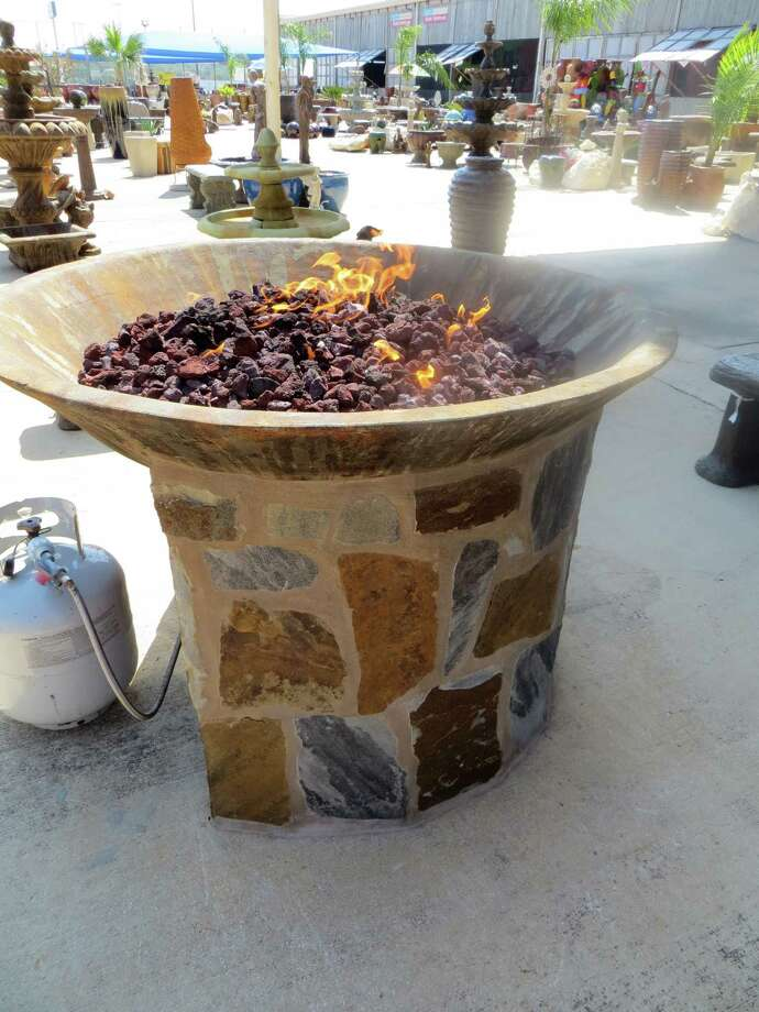Head to The Rustic Warehouse for this fire pit, $500, that uses cinder blocks and a propane tank. Photo: Jennifer Rodriguez, For The Express-News