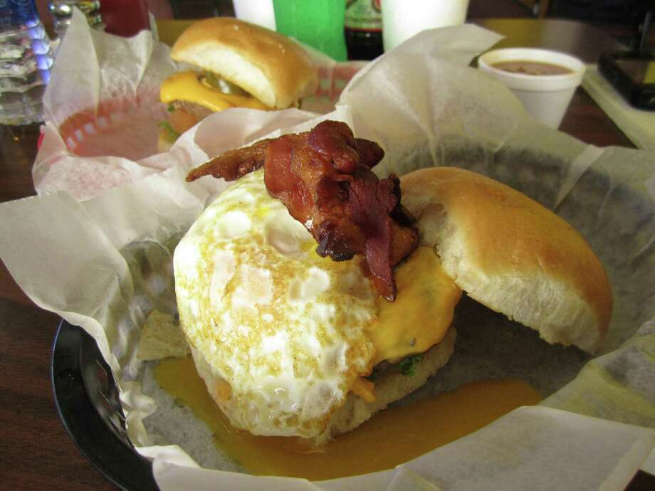 The Breakfast Burger and the Spicy Jalapeño Burger are two variations from Mark's Outing.  Photo: Jessica Elizarraras, San Antonio Express-News
