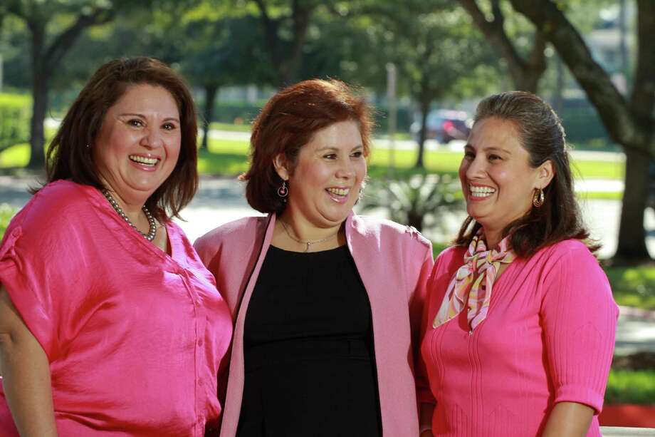 Sisters Diana Labrada, from left, Yadira Labrada and Tamara Labrada, all have survived breast cancer. The sisters opted for genetic testing. Photo: Gary Fountain / Copyright 2012 Gary Fountain.