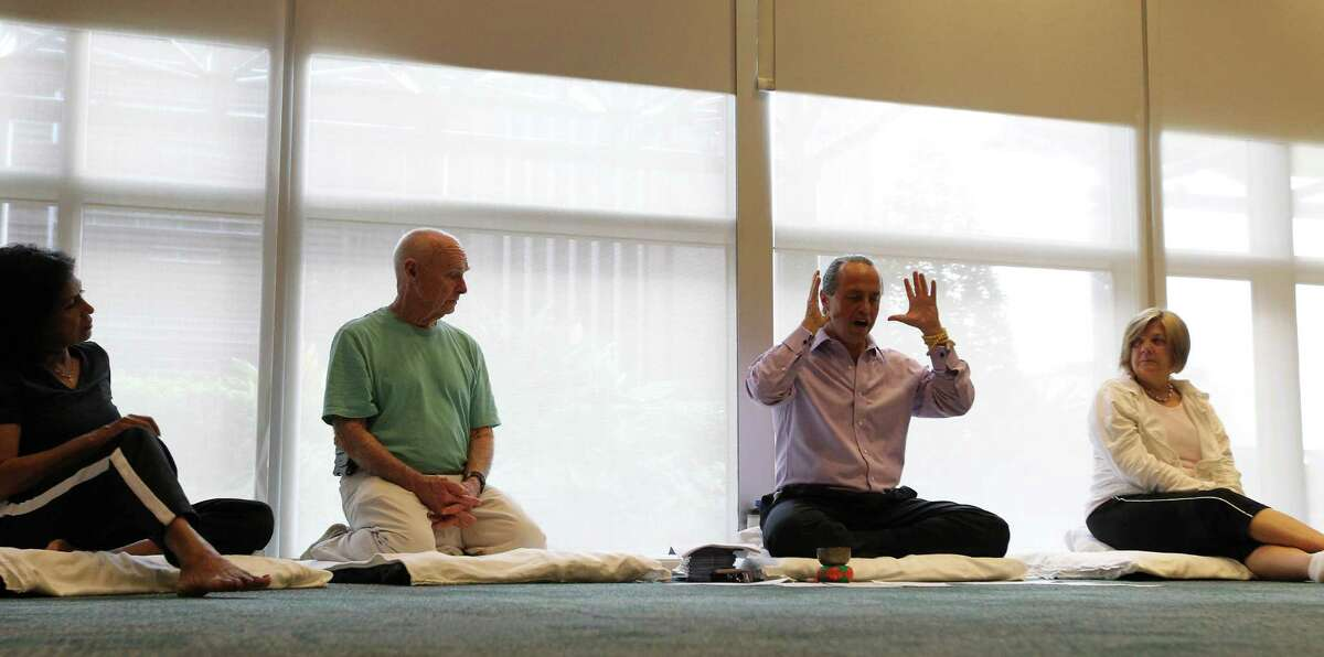 Alejandro Chaoul, third from left, discusses the basics of meditation for cancer patients and caregivers at the University of Texas M.D. Anderson Cancer Center's Mays Clinic. Chaoul leads free classes to help cancer patients cope with anxiety and the disease's tough treatment.