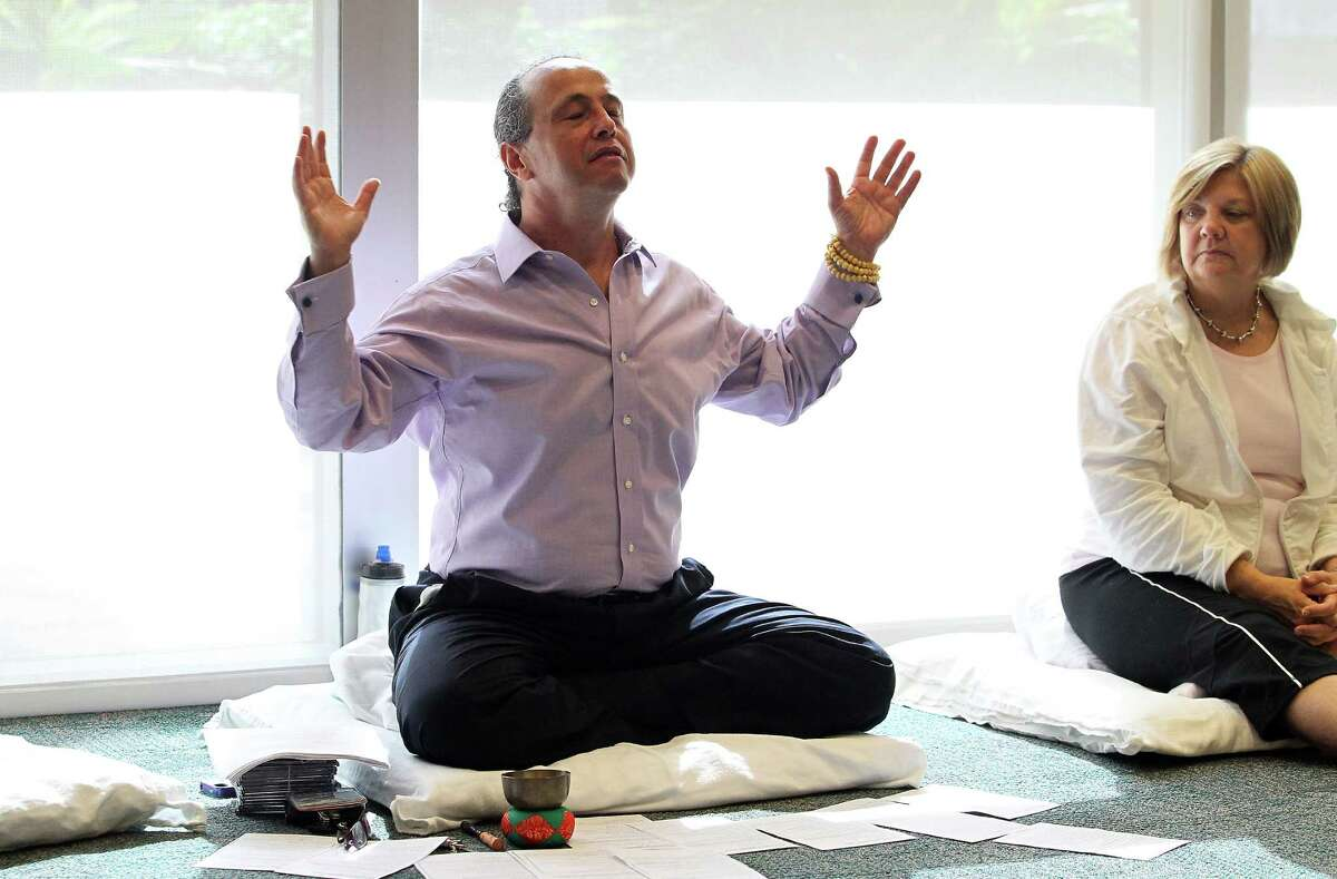 Alejandro Chaoul, discusses the basics of meditation during the meditation class for cancer patients and caregivers at the MD Anderson Mays Clinic, Tuesday, Sept. 25, 2012, in Houston. Chaoul, professor at MD Anderson, teaches meditation to cancer patients that helps them cope with their anxiety and allows them to sleep better. The inability to sleep well is a complication faced by many cancer patients and affects their treatment. ( Karen Warren / Houston Chronicle )