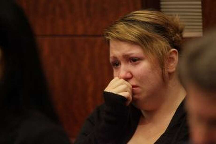 Tiffany Dickerson, mother of fire victim Shomari Dickerson, weeps during opening statements in the Jessica Tata trial at the Harris County Criminal Courthouse on Wednesday, Oct. 24, 2012, in Houston. Jessica Tata is accused in the deaths of four children at her west Houston daycare. Photo: Mayra Beltran, Houston Chronicle /  2012 Houston Chronicle