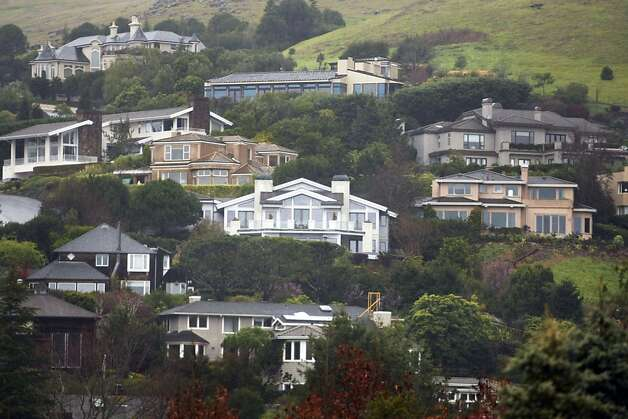Large homes sit side by side in Tiburon Calif, on Friday, Feb. 18, 2011.Large homes sit side by side in Tiburon Calif, on Friday, Feb. 18, 2011. Ran on: 02-20-2011Mansions nestle into the hillside at Tiburon. But large homes, one vision of the American dream, are subsidized by taxpayers through the mortgage interest deduction. Some argue it needs modification.Ran on: 02-20-2011Mansions nestle into the hillside at Tiburon. But large homes, one vision of the American dream, are subsidized by taxpayers through the mortgage interest deduction. Some argue it needs modification. Photo: Alex Washburn, The Chronicle