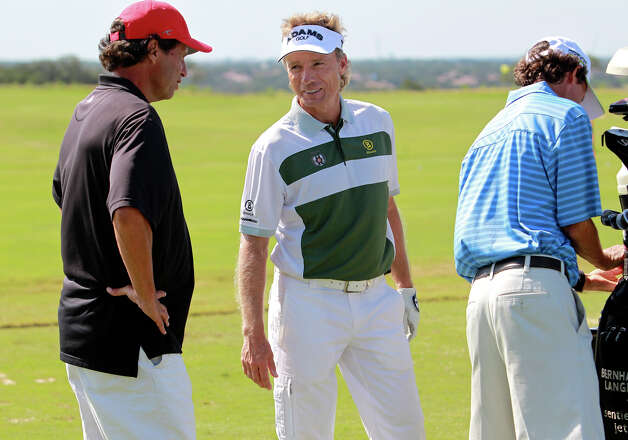 Bernhard Langer takes time to talk equipment on the driving range during the AT&T Championship Pro-Am  on October 24, 2012. Photo: Tom Reel, San Antonio Express-News / San Antonio Express-News
