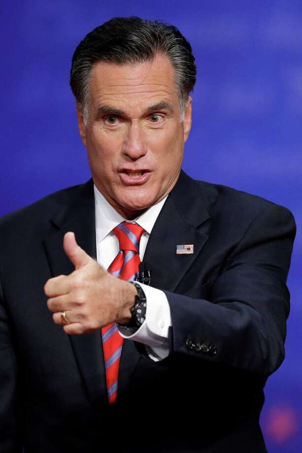 Republican presidential nominee Mitt Romney flashes a thumbs up to the audience after the third presidential debate at Lynn University, Monday, Oct. 22, 2012, in Boca Raton, Fla. (AP Photo/Charlie Neibergall) Photo: AP, STF / New