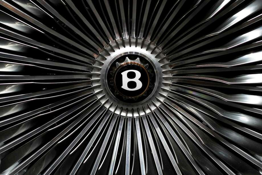 The center of a wheel of a Bentley EXP 9 F is seen during a press day ahead of the 82nd Geneva Motor Show on March 7, 2012 in Geneva Photo: FABRICE COFFRINI, AFP/Getty Images / 2012 AFP
