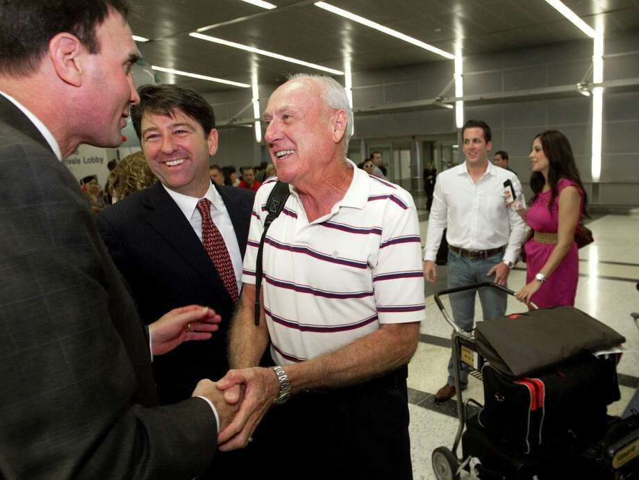 Rep. Pete Olson, R-Texas, left, greets pilot Carl Moody upon his arrival from Panama. Moody and co-pilot Kenny Chonoski, shown in the background, a pair of Houston-based private jet pilots, were jailed in Panama in May 2011 when customs officials there found $2.3 million of supposed drug money in the baggage of a passenger. Photo: Brett Coomer, Houston Chronicle / Houston Chronicle