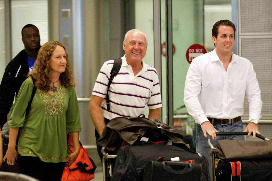 Joanna Moody, left, walks with her pilot husband, Carl Moody, center, and pilot Kenny Chonoski upon their arrival from Panama. The two were back on U.S. soil for the first time since March when they were allowed a brief return from Panama. Photo: Brett Coomer, Houston Chronicle / Houston Chronicle
