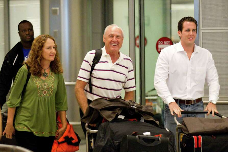 Joanna Moody, left, walks with her pilot husband, Carl Moody, center, and pilot Kenny Chonoski upon