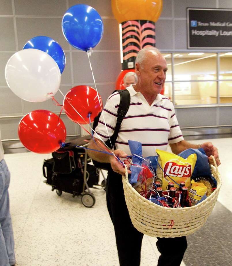 "Carl Moody carries his ""All-American"" basket upon arrival from Panama at Bush airport. Photo: Brett Coomer, Houston Chronicle / Houston Chronicle"