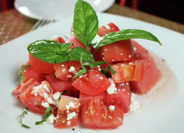 Tomato watermelon salad at A Tempo, Tuesday October 23, 2012 Photo: Juanito M Garza, San Antonio Express-News / San Antonio Express-News