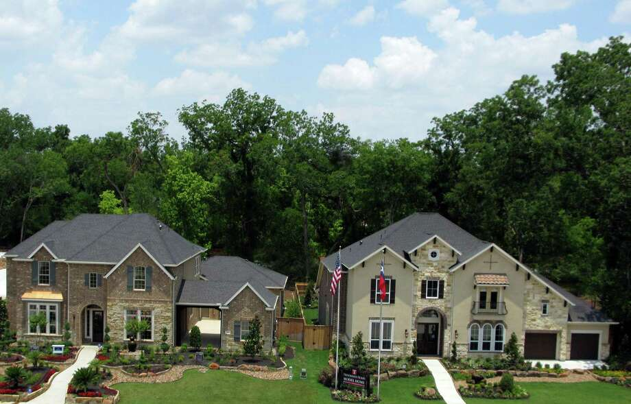 Many new neighborhoods in Riverstone are enhanced by wooded landscapes, with four open now and dozens planned over the next five years. The Orchard neighborhood, shown, features homes by David Weekley and Trendmaker, with prices from the $430,000s.