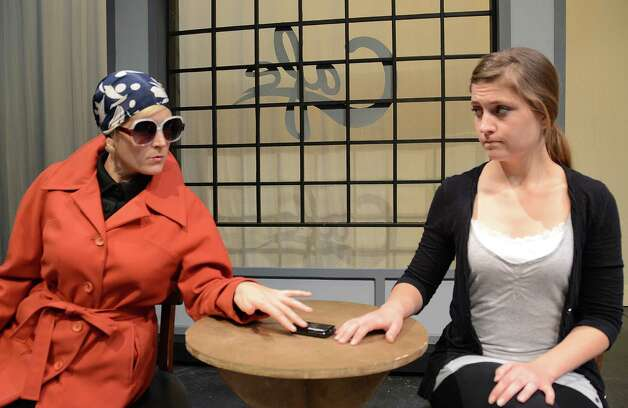 "Grace Mathis as the Other Woman and Laura Mackan as Jean, left to right, will appear in BCP's production of ""Dead Man's Cell Phone."" Photo: Courtesy"