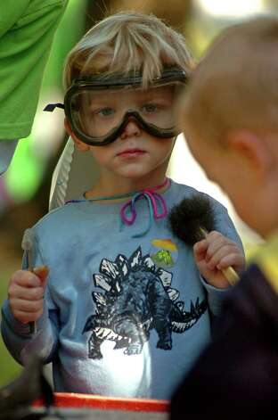 Thomas Foster, 3, of Lumberton prepares to search for fossils during Dinosaur Day in the museum district in Beaumont on Saturday, Oct. 27, 2007. The Texas Energy Museum invited children for activities to explore science.   Mark M. Hancock / The Beaumont Enterprise Photo: Mark M. Hancock, Staff Photojournalist / The Beaumont Enterprise
