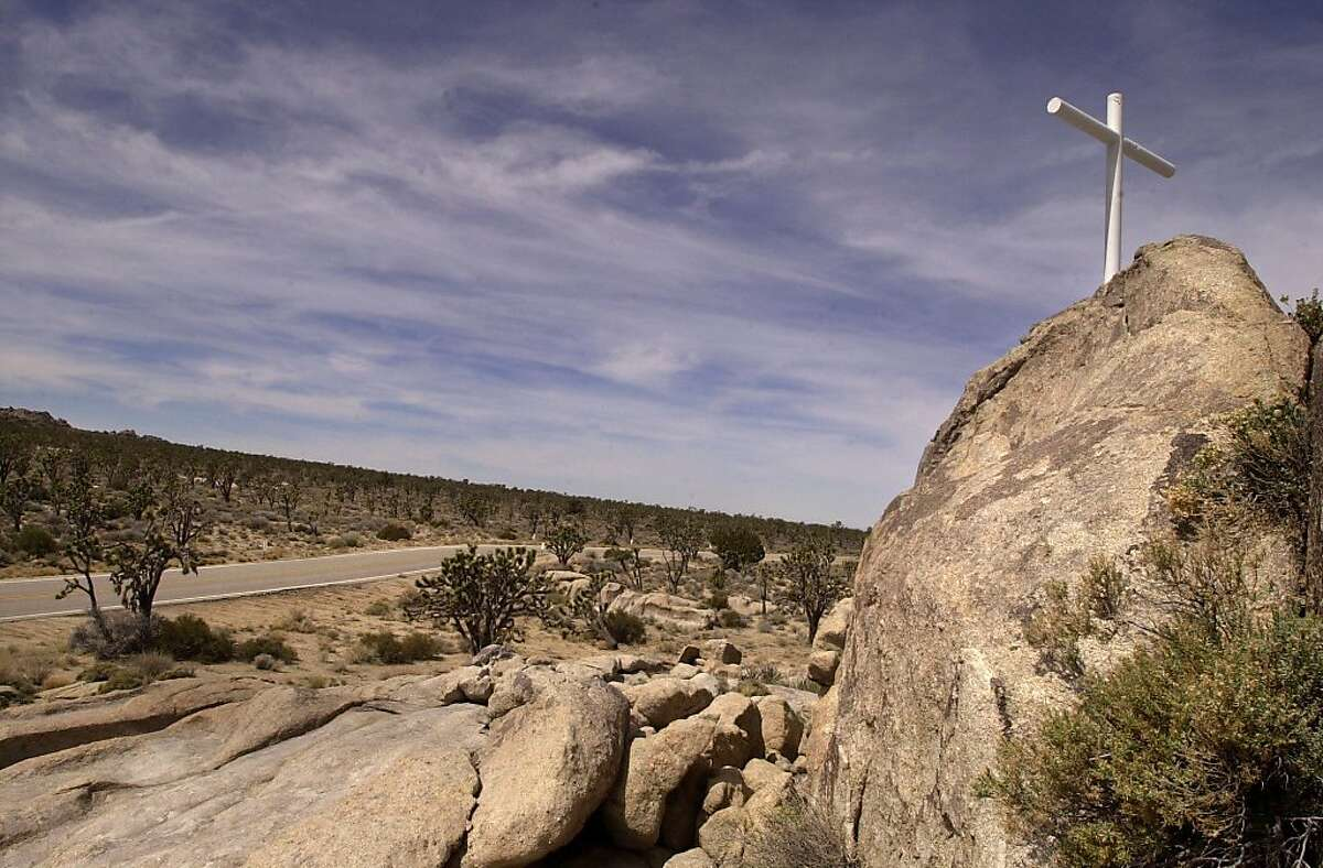 FILE - This 2002 photo shows the Mojave Cross in the Mojave National Preserve. Authorities say the 7-foot-tall cross that sparked a U.S. Supreme Court dispute was stolen around May 9, 2010.