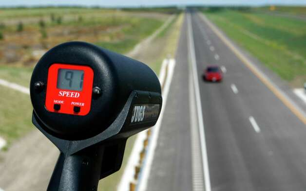 A car is unofficially clocked going 91 mph Wednesday afternoon Oct. 24, 2012 on the southern extension of Texas 130 from Seguin to Austin on the toll road's opening day. The road has the highest speed limit--85 mph--of any road in the country.An Express-News staffer held the radar gun to clock the unofficial speed of the passing vehicles. Photo: William Luther, San Antonio Express-News / © 2012 San Antonio Express-News