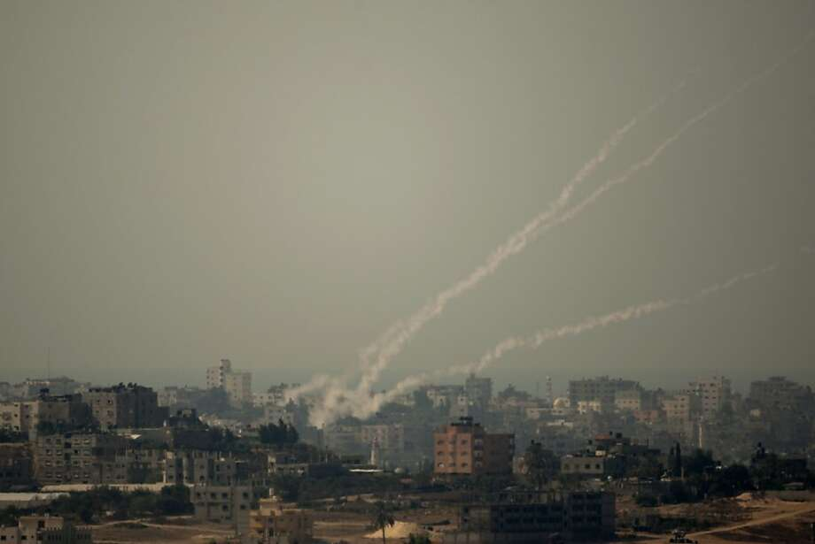 Smoke trails from rockets fired by Palestinian militants from the Gaza Strip toward Israel. More than 60 rockets were fired into southern Israel. Photo: Ariel Schalit, Associated Press