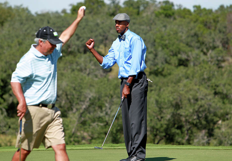 Bruce Bowen stays cool after dropping a birdie putt for his team on 16 during the AT&T Championship Pro-Am  on October 24, 2012. Photo: Tom Reel, San Antonio Express-News / San Antonio Express-News