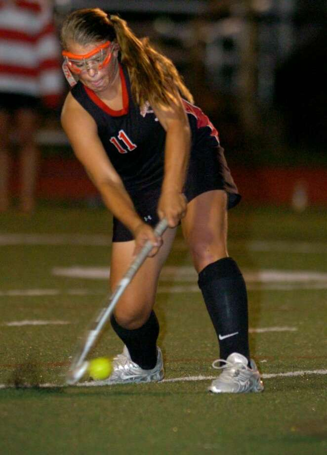 Fairfield Warde's Stacey Dileo takes a shot during Tuesday night's field hockey game against Ludlowe at Taft Field in Fairfield. Photo: Autumn Driscoll / Connecticut Post