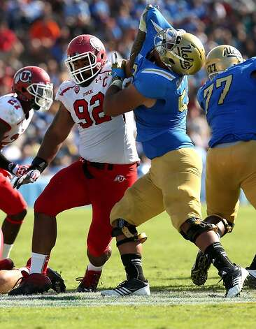 PASADENA, CA - OCTOBER 13:  Defensive tackle Star Lotulelei #92 of the Utah Utes battles offensive lineman Xavier Su'a-Filo #56 of the UCLA Bruins at the Rose Bowl on October 13, 2012 in Pasadena, California. UCLA won 21-14.  (Photo by Stephen Dunn/Getty Images) Photo: Stephen Dunn, Getty Images