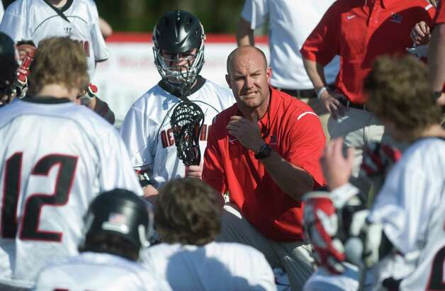 New Canaan High School's head coach Alex Whitten against Darien High School in boys lacrosse in New Canaan, Conn. on Saturday May 7, 2011. Photo: Kathleen O'Rourke, ST