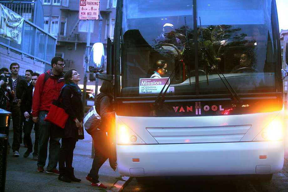 A shuttle to the Google campus loading passengers on the 24th at Valencia street bus stop in San Francisco, Calif., during the morning commute on Tuesday, October 23, 2012.  San Francisco supervisor John Avalos has introduced legislation to regulate these private shuttles. Photo: Liz Hafalia, The Chronicle
