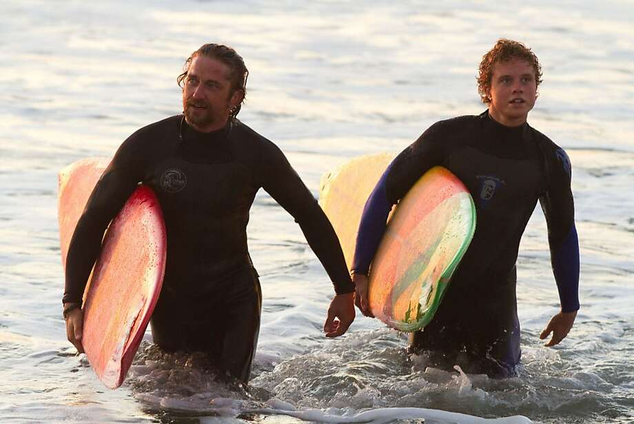 "Gerard Butler (left) plays Frosty Hesson, who trains Jay Moriarity, played by Jonny Weston, in the art of big wave surfing in ""Chasing Mavericks."" Photo: John P. Johnson, Associated Press"