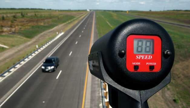 A car is unofficially clocked going 88 mph Wednesday afternoon Oct. 24, 2012 on the southern extension of Texas 130 from Seguin to Austin on the toll road's opening day. The road has the highest speed limit--85 mph--of any road in the country. An Express-News staffer held the radar gun to clock the unofficial speed of the passing vehicles. Photo: William Luther, San Antonio Express-News / © 2012 San Antonio Express-News