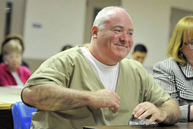 Michael Skakel reacts during a parole hearing at McDougall-Walker Correctional Institution in Suffield, Conn., Wednesday, Oct. 24, 2012.  Parole officials denied Skakel's first bid for parole since he was convicted a decade ago of killing his neighbor  in 1975.  Skakel is serving 20 years to life for fatally beating Martha Moxley with a golf club in Greenwich when they were 15-year-old neighbors. Photo: Jessica Hill, Jessica Hill/Associated Press / POOL FR125654 AP