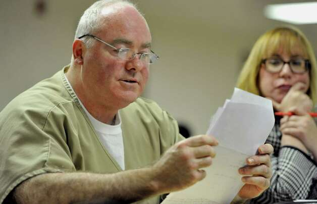 Michael Skakel reads a statement during a parole hearing at McDougall-Walker Correctional Institution in Suffield, Conn., Wednesday, Oct. 24, 2012.  Parole officials denied Skakel's first bid for parole since he was convicted a decade ago of killing his neighbor  in 1975.  Skakel is serving 20 years to life for fatally beating Martha Moxley with a golf club in Greenwich when they were 15-year-old neighbors. Photo: Jessica Hill, Jessica Hill/Associated Press / POOL FR125654 AP
