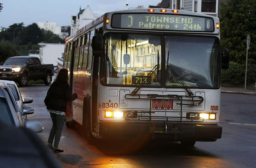 In this file photo, A passengers boards an inbound 10-Townsend Muni bus at Laguna and Washington streets in San Francisco.