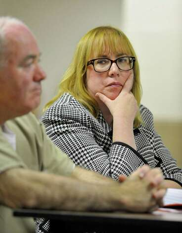 Hope Seeley, attorney for Michael Skakel, looks toward her client during a parole hearing at McDougall-Walker Correctional Institution in Suffield, Conn., Wednesday, Oct. 24, 2012.  Parole officials denied Skakel's first bid for parole since he was convicted a decade ago of killing his neighbor  in 1975.  Skakel is serving 20 years to life for fatally beating Martha Moxley with a golf club in Greenwich when they were 15-year-old neighbors. Photo: Jessica Hill, Jessica Hill/Associated Press / POOL FR125654 AP