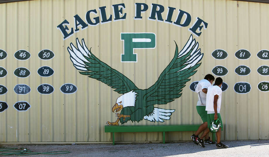 Players head out to practice Wednesday at Pleasanton High School. The Eagles are off to an 8-0 start after struggling through a 2-8 season just a year ago. Photo: Kin Man Hui, San Antonio Express-News / San Antonio Express-News