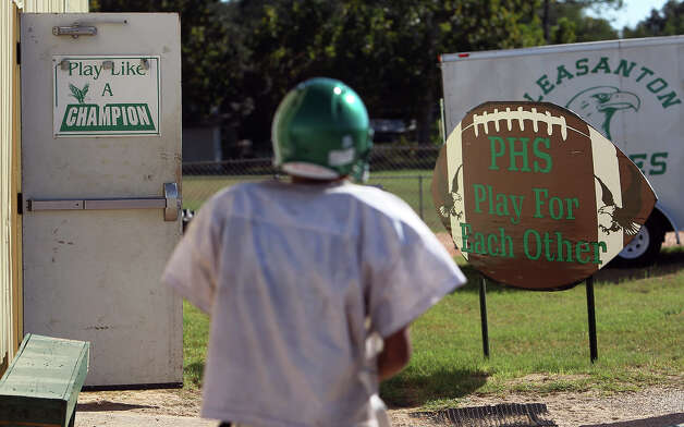 A football player heads out to practice at Pleasanton High School on Wednesday, Oct. 24, 2012. The Eagles are 8-0 this season after going 2-8 last year. Photo: Kin Man Hui, San Antonio Express-News / San Antonio Express-News