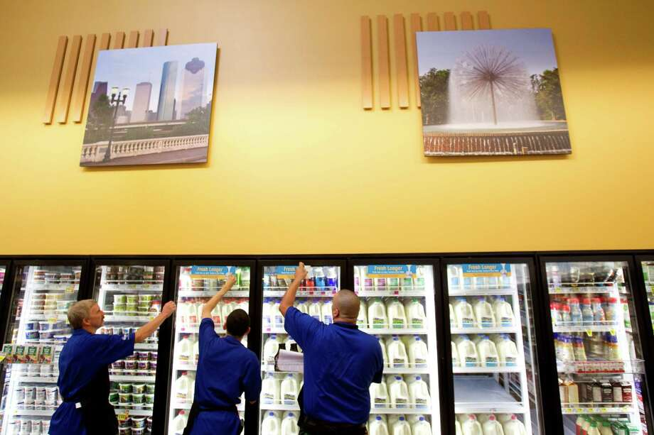 Photos of various Houston scenes adorn the walls of the new Kroger on Studemont Wednesday, Oct. 24, 2012, in Houston. The signature grocery store is scheduled to open October 26. Photo: Brett Coomer, Houston Chronicle / © 2012 Houston Chronicle