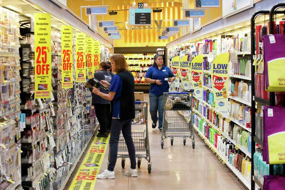 Stockers prepare the shelves at the new Kroger on Studemont Wednesday, Oct. 24, 2012, in Houston. The signature grocery store is scheduled to open October 26. Photo: Brett Coomer, Houston Chronicle / © 2012 Houston Chronicle