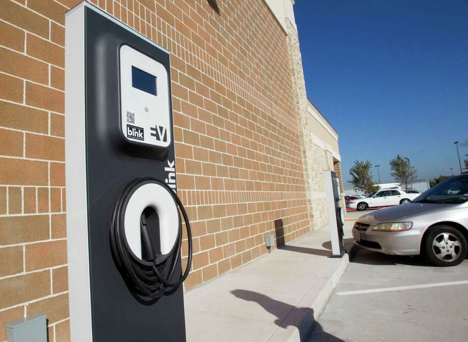 The electric charging stations at the new Kroger on Studemont are shown outside the store Wednesday, Oct. 24, 2012, in Houston. The signature grocery store is scheduled to open October 26. Photo: Brett Coomer, Houston Chronicle / © 2012 Houston Chronicle