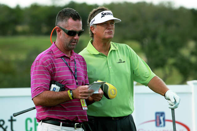 Peter Jacobsen gets advice on the nnth tee from his caddy during the AT&T Championship Pro-Am  on October 24, 2012. Photo: Tom Reel, San Antonio Express-News / San Antonio Express-News