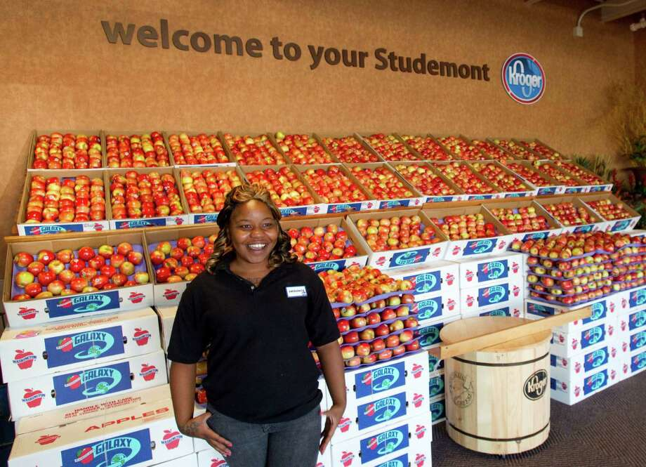 Sheronica Crump stands in the entrance of the new Kroger on Studemont Wednesday, Oct. 24, 2012, in Houston. The signature grocery store is scheduled to open October 26. Photo: Brett Coomer, Houston Chronicle / © 2012 Houston Chronicle