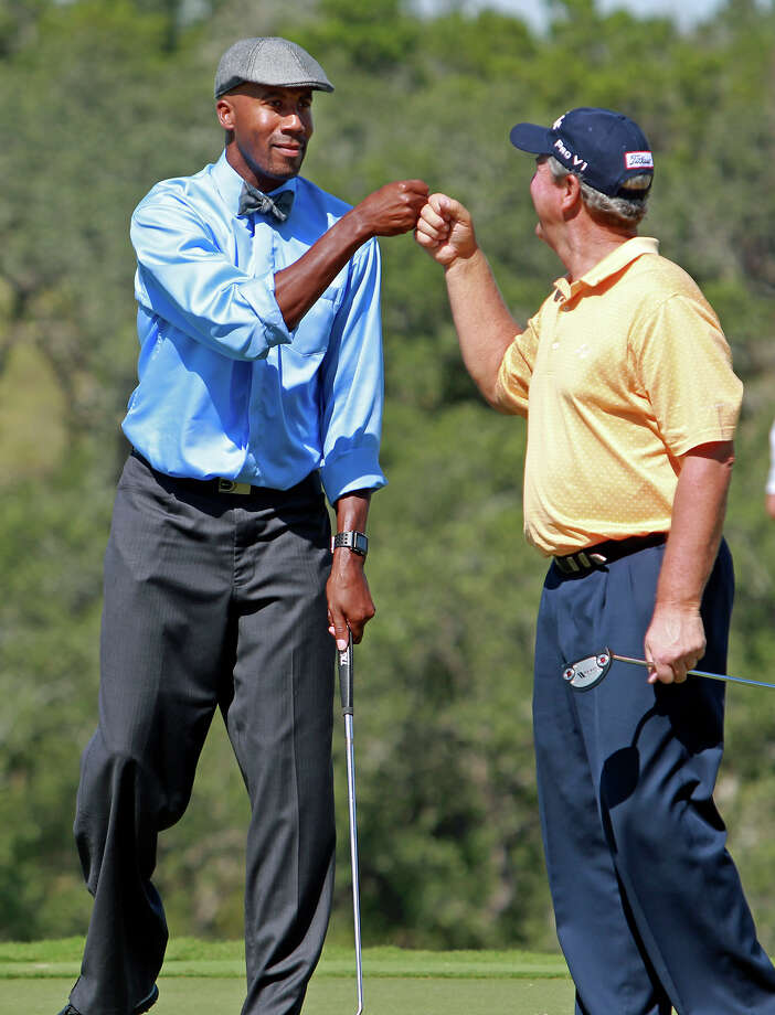 Bruce Bowen is congratulated golf pro Tom Purtzer after the Spurs great sank a birdie putt on 16 during the AT&T Championship Pro-Am  on October 24, 2012. Photo: Tom Reel, San Antonio Express-News / San Antonio Express-News