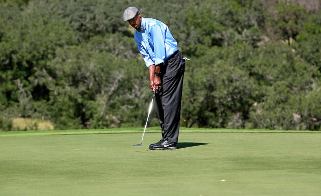 The ball drops into the center of the cup for Bruce Bowen who made birdie on 16 during the AT&T Championship Pro-Am  on October 24, 2012. Photo: Tom Reel, San Antonio Express-News / San Antonio Express-News