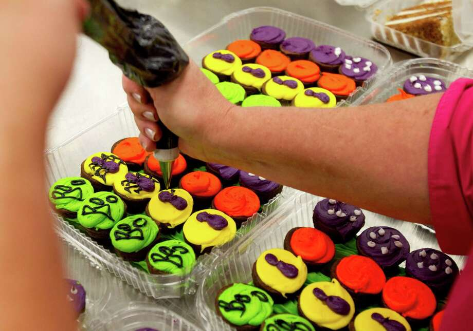 Cupcakes are decorated for Halloween at the new Kroger on Studemont Wednesday, Oct. 24, 2012, in Houston. The signature grocery store is scheduled to open October 26. Photo: Brett Coomer, Houston Chronicle / © 2012 Houston Chronicle