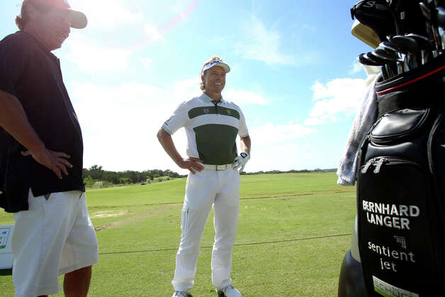 Bernhard Langer enjoys a chat at the driving range during the AT&T Championship Pro-Am  on October 24, 2012. Photo: Tom Reel, San Antonio Express-News / San Antonio Express-News