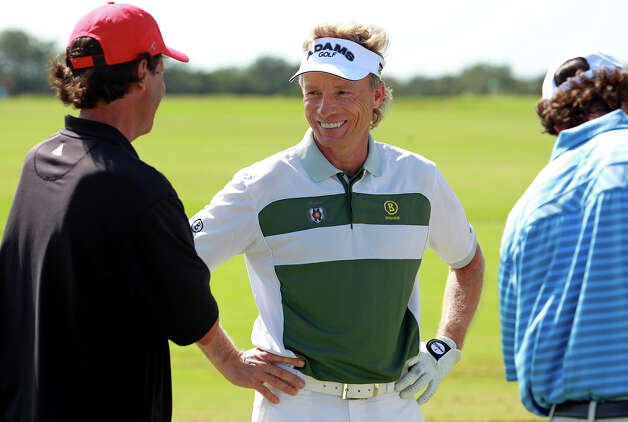 Bernhard Langer chats with an equipment representative on the driving range during the AT&T Championship Pro-Am  on October 24, 2012. Photo: Tom Reel, San Antonio Express-News / San Antonio Express-News
