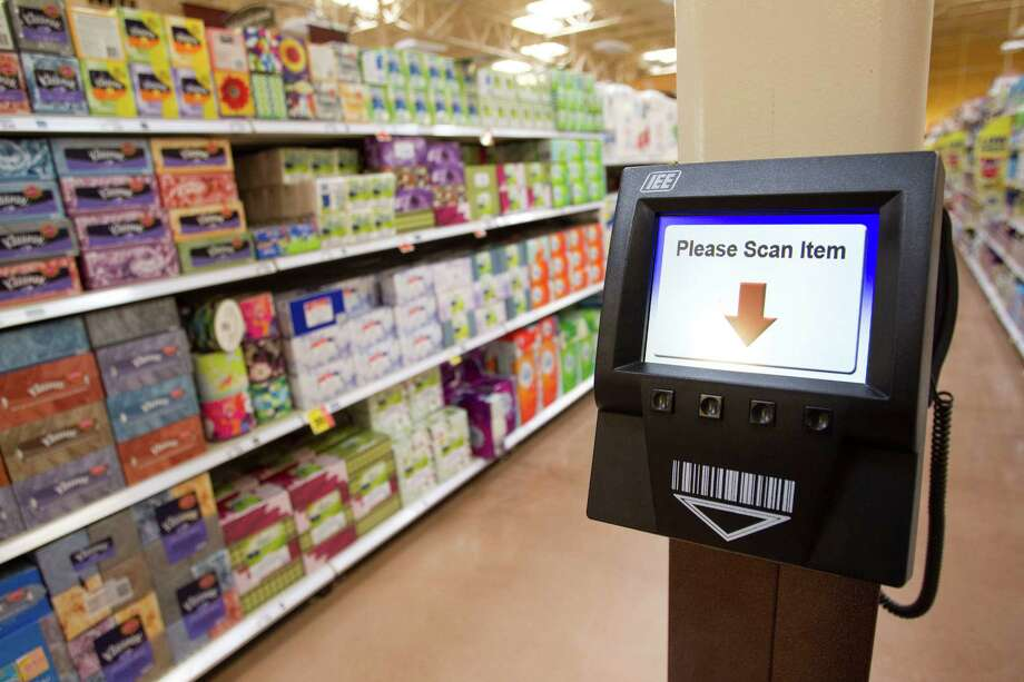 A price scanner is shown at the new Kroger on Studemont Wednesday, Oct. 24, 2012, in Houston. The signature grocery store is scheduled to open October 26. Photo: Brett Coomer, Houston Chronicle / © 2012 Houston Chronicle
