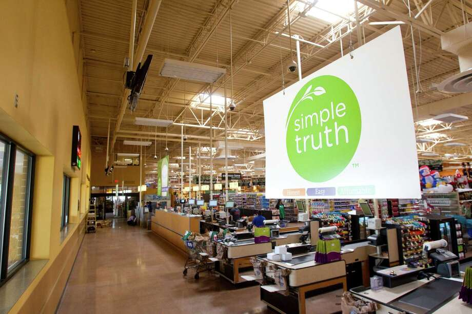 Kroger's Simple Truth organic foods are advertised near the checkout stands at the new Kroger on Studemont Wednesday, Oct. 24, 2012, in Houston. The signature grocery store is scheduled to open October 26. Photo: Brett Coomer, Houston Chronicle / © 2012 Houston Chronicle
