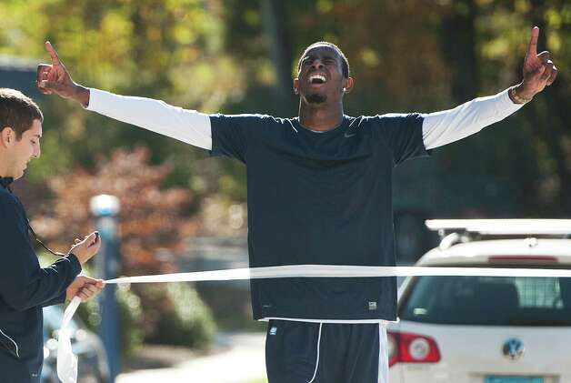 Connecticut's DeAndre Daniels crosses the finish line as the first player in the Husky Run in Storrs, Conn., Thursday, Oct. 11, 2012.(AP Photo/Jessica Hill) Photo: Jessica Hill, Associated Press / FR125654 AP