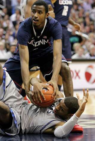 Connecticut's DeAndre Daniels, top, and Georgetown's Hollis Thompson battle for the ball during the first half of an NCAA college basketball game on Wednesday, Feb. 1, 2012, in Washington. (AP Photo/Haraz Ghanbari) Photo: Haraz Ghanbari, Associated Press / AP