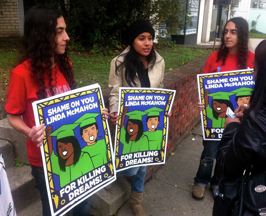 Carolina Bortolleto, 24, of Danbury, Yumi Perez, 21, of Bridgeport, and BortolletoâÄôs twin sister, Camila, also of Danbury, waged a small protest outside of Republican U.S. Senate candidate Linda McMahonâÄôs campaign office in Bridgeport, Conn. on Wednesday, Oct. 24, 2012. The women are trying to draw attention to McMahonâÄôs positions on immigration reform, which they say do not go far enough to help undocumented immigrants like themselves who were brought to the United States as young children. Photo: Brian Lockhart