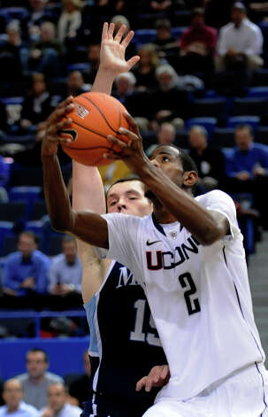 Connecticut's DeAndre Daniels goes up past Maine's Alasdair Fraser for a shot in the first half of an NCAA college basketball game in Hartford, Conn., Thursday, Nov. 17, 2011. (AP Photo/Bob  Child) Photo: Bob Child, Associated Press / FR170410 AP